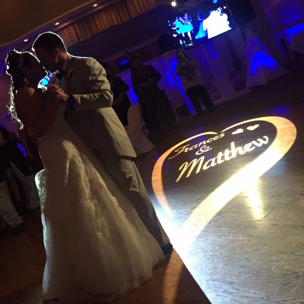 Bride & Groom dancing with custom gobo projection